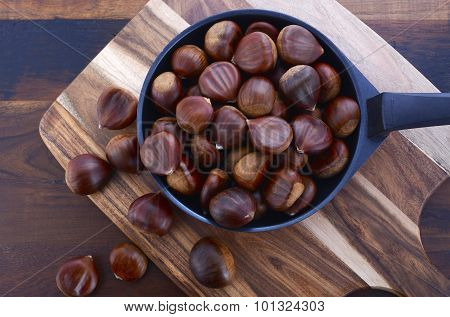 Chestnuts On Rustic Wood Table