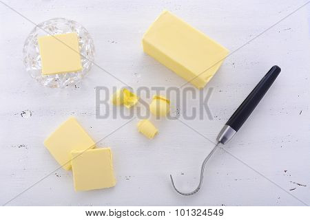 Butter On White Wood Table.
