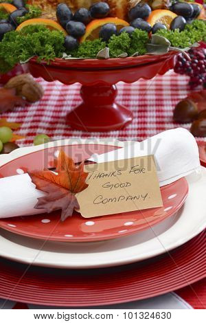 Thanksgiving Table Setting With Roast Turkey On Red White Background.