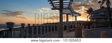view of gazebo overlooking the harbor at sunset