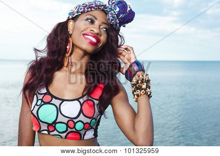 Young beautiful African American girl relaxing at the beach.