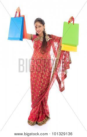Indian woman in traditional sari shopping for diwali festival, full length standing isolated on white background.