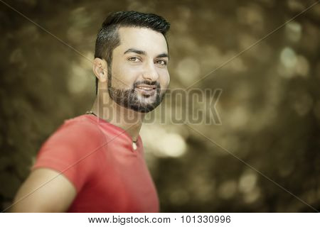 An image of a young man with a beard