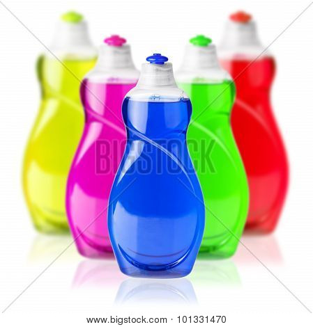 colorful soap dish bottles on white background