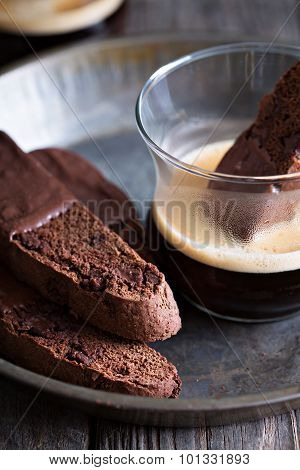 Chocolate biscotti cookies with a cup of coffee