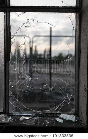 Smashed Glass Window Frame With Blurred Background