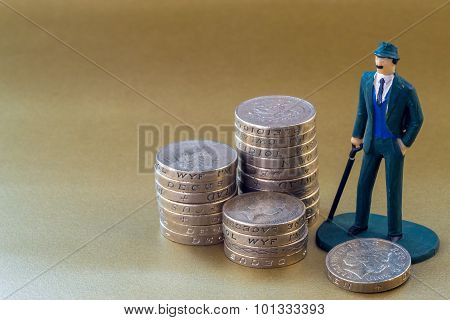 Single Business Man Miniature Toy And English One Pound Coins