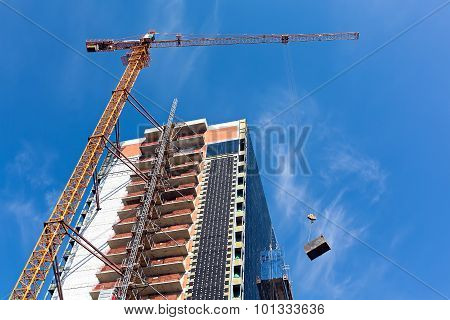 Tower Crane Working On Construction Site