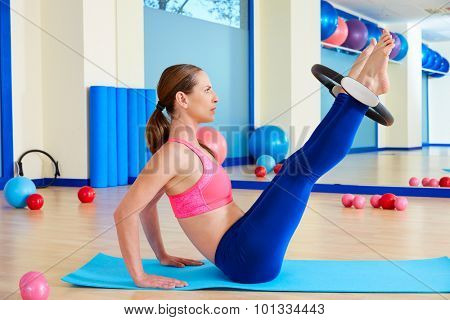 Pilates woman hip twist magic ring exercise workout at gym indoor