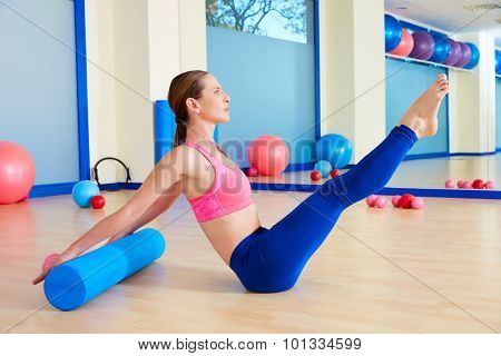 Pilates woman roller teaser roll exercise workout at gym indoor