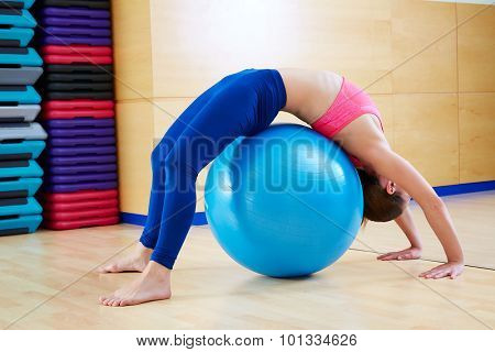 Pilates woman gymnastics bridge fitball exercise workout at gym indoor swiss ball