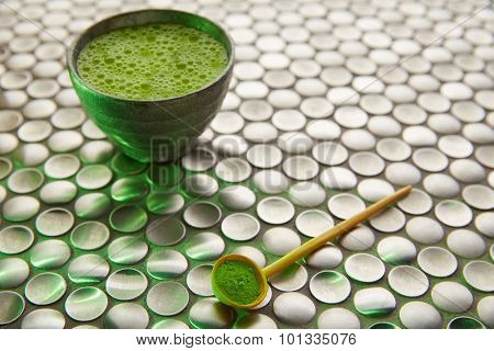 Matcha green tea from Japan on modern stainless steel background