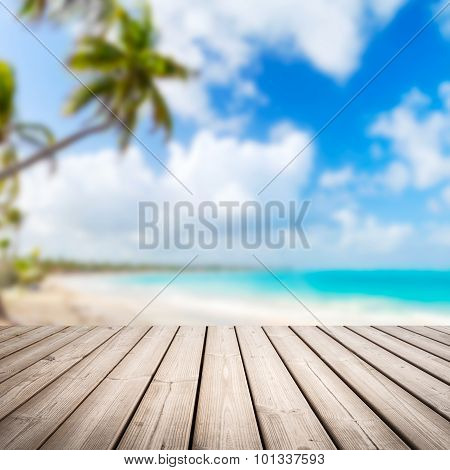 Empty Wooden Pier Over Blurred Tropical Beach