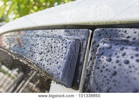 Close Up Raindrops On Car And Glass
