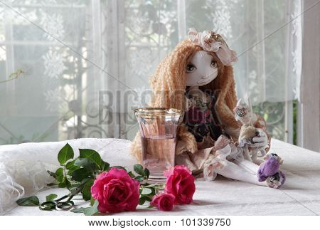 Doll, Roses, Scissors And A Vase With Water