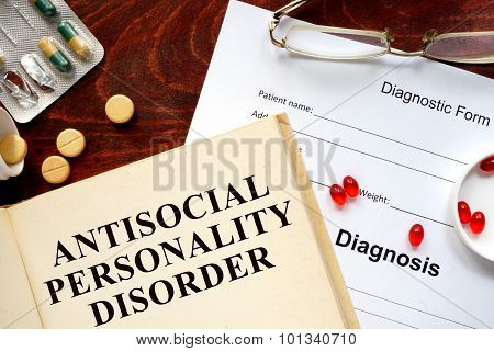antisocial personality disorder written on book with tablets.