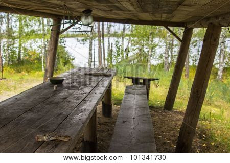 abandoned area for outdoor recreation: wooden bench and a table