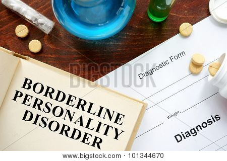 Borderline personality disorder written on book with tablets.