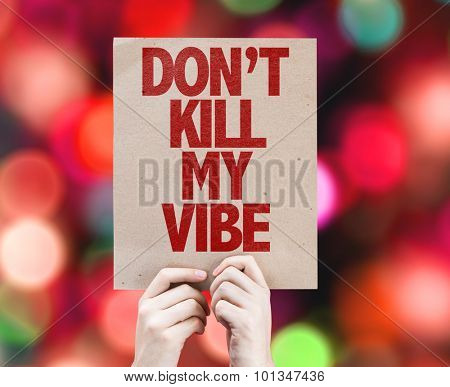 Don't Kill My Vibe cardboard with bokeh background