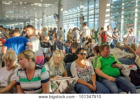 Tivat, Montenegro - September 11, 2015: People Sitting In The Relegation Zone , Waiting For Their Fl
