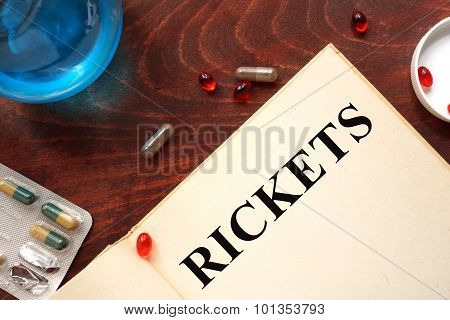 Rickets written on book with tablets.