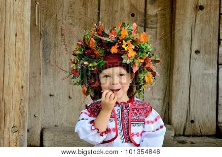 Girl In The Ukrainian National Clothes With Folk Toys