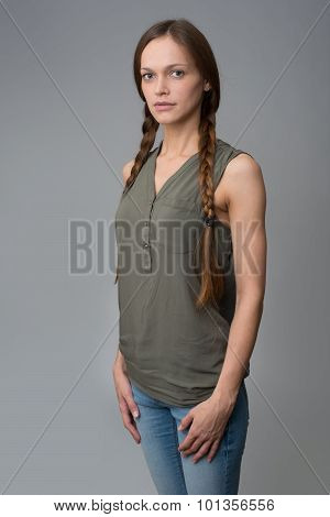 Portrait Of Beautiful Woman With Pigtails
