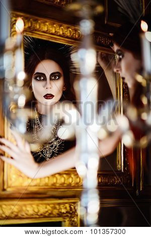 Gothic Fashion: Mysterious Beautiful Young Woman Looking Into Mirror