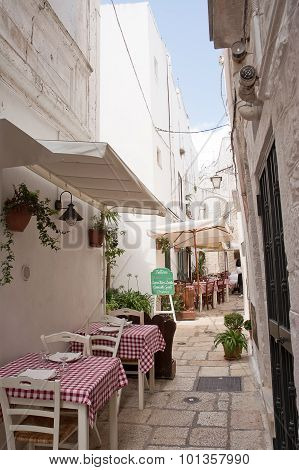 Table Set In The Alley Of Cisternino (apulia)