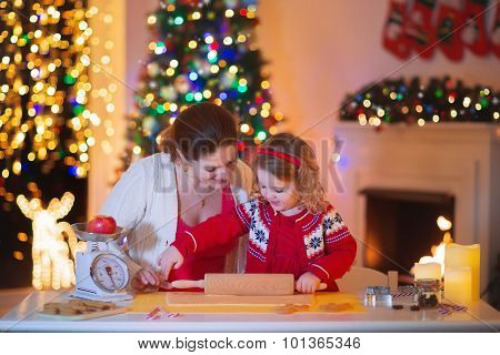 Mother And Daughter Baking Gingerbread For Christmas Dinner