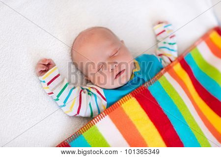 Little Baby Boy Sleeping Under Colorful Blanket
