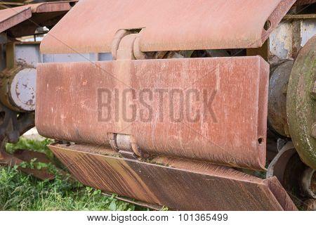 Rusty wheels of big backhoe