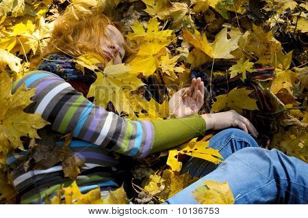 Woman In Autumn Leaves