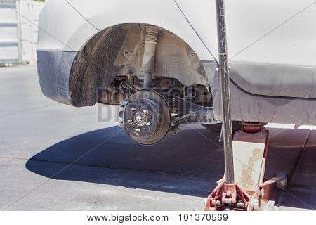 Automotive Concept: Car Wheel Is Being Maintained On Professional Car Repair Station.