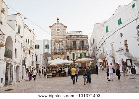 Tourists In The Evening In The watch Square In Cisternino  August 23, 2015