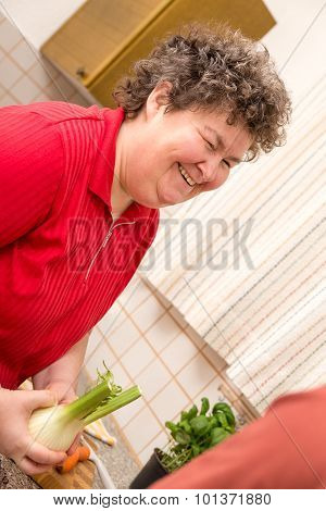 Mentally Disabled Woman In The Kitchen Is Glad
