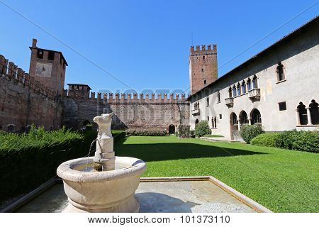 VERONA, ITALY - SEPTEMBER 2014 : An ancient A bull-headed fountain in the courtyard at Castelvecchio Museum (Museo Civico di Castelvecchio) in Verona, Italy on September 14, 2014.