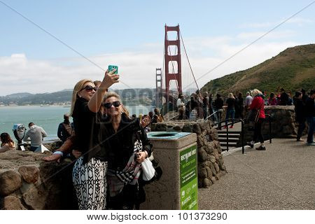 Women Take Selfie With Golden Gate Bridge In Background