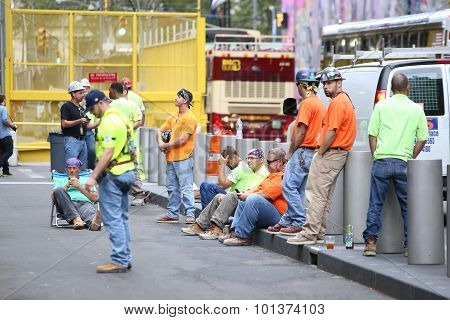 Construction workers during moment of silence