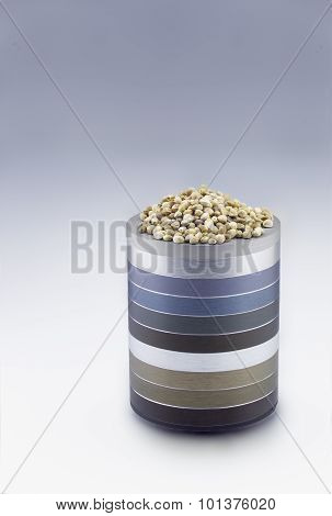 Hemp Seeds On Metallic Rings Pedestal