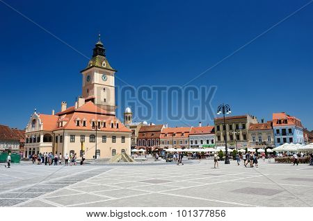 Brasov, Transylvania, Romania, 6th July 2015: Brasov Council Square is historical center of city, people walkinng and sitting at outdoor terraces and restaurants.