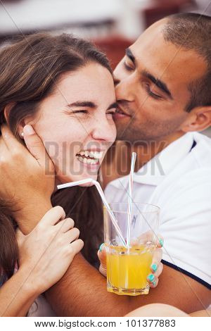 Couple having fun in an outdoor bar