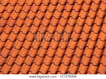 Red Clay Tile Roof On Old Farm House Background