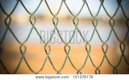 Embroidery Of A Metal Fence