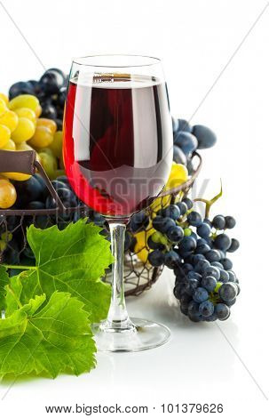 Glass red wine with cluster grapes
