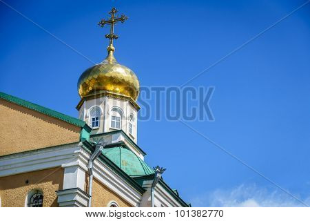 Classic gold-plated onion dome of a Russian Orthodox church against blue sky