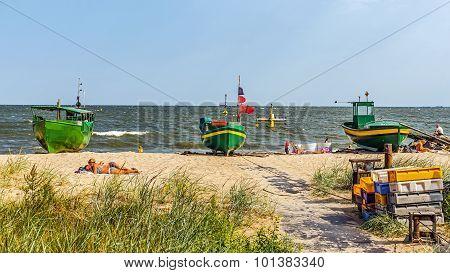People sunbath on a beach in Orlowo
