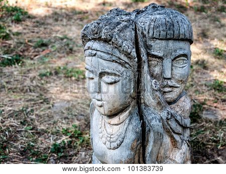 The Wooden Figure Of A Man And Woman