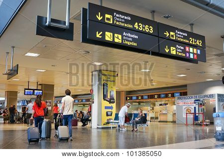 VALENCIA, SPAIN - SEPTEMBER 12, 2015: Airline passengers inside the Valencia Airport. About 4.59 million passengers passed through the airport in 2014.