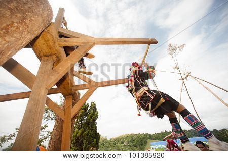 Akha Woman In Traditional Dress Playing Akha Swing Festival.